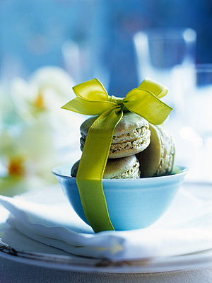 Macaroons tied with yellow ribbon - p349m2167661 by Polly Wreford
