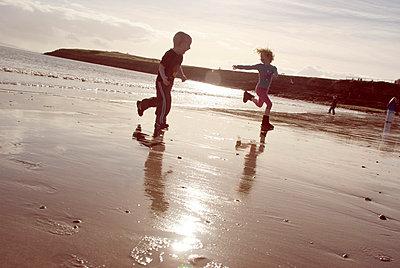 Children on a sandy beach - p5970302 by Tim Robinson