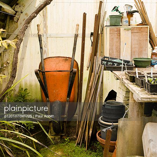 Wheelbarrow in greenhouse - p1201m1041725 by Paul Abbitt