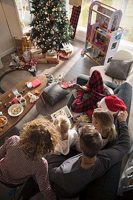 Family taking selfie with digital tablet in Christmas living room - p1192m1512249 by Hero Images