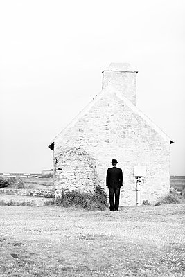 Man in front of a house - p1096m880041 by Rajkumar Singh