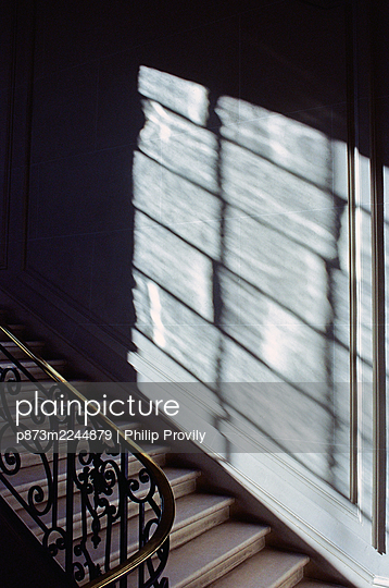 Staircase and banister rail in the sunlight - p873m2244879 by Philip Provily