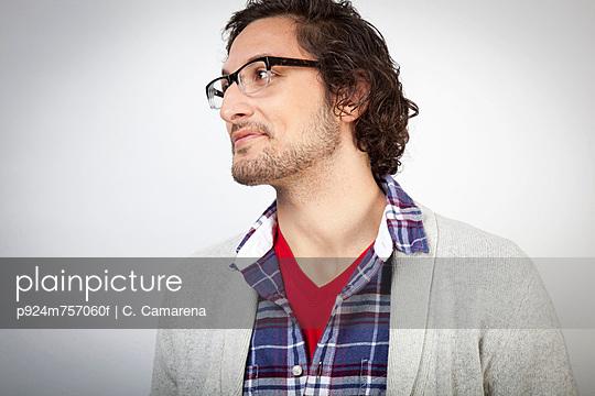 Smiling man wearing glasses - p924m757060f by C. Camarena