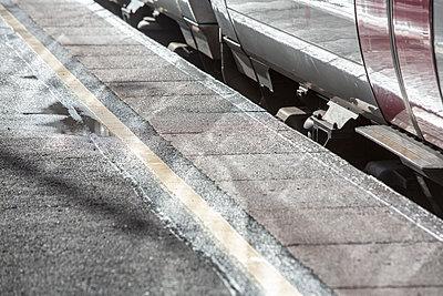 Rail train with platform reflecting the bright winter sun. - p1057m2044770 by Stephen Shepherd