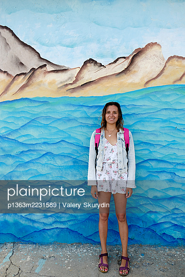 Girl on the background of the painted sea - p1363m2231589 by Valery Skurydin