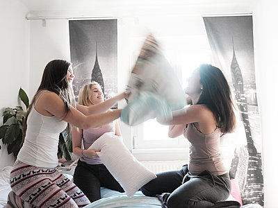 Pillow fight - p1383m2045119 by Wolfgang Steiner