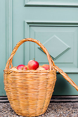 Basket with apples - p312m1121614f by Rebecca Wallin