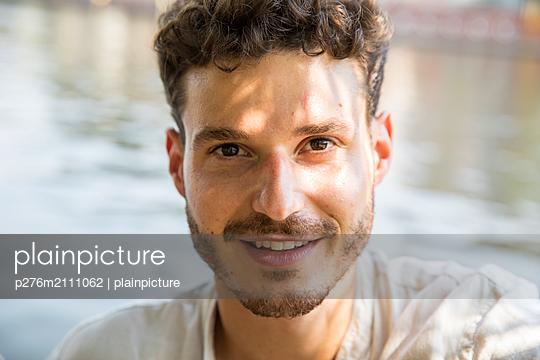 Portrait of young man - p276m2111062 by plainpicture