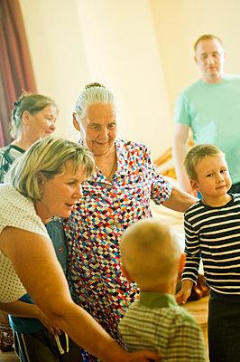 Caucasian multi-generation family relaxing indoors - p555m1413583 by Aleksander Rubtsov