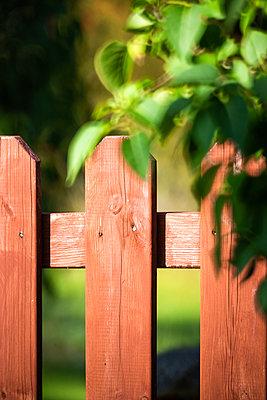 Red garden fence - p1418m2124808 by Jan Håkan Dahlström