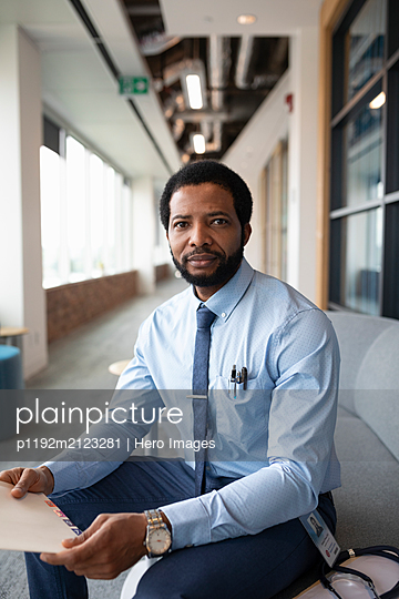 Portrait of medical consultant looking at camera - p1192m2123281 by Hero Images