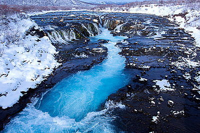 River flowing from waterfall, Bruarfoss, Sudhurland, Iceland - p555m1420433 by Pete Saloutos