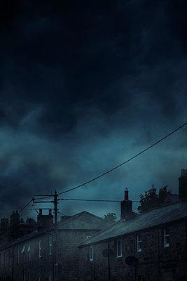 Houses under dark sky - p1248m2297520 by miguel sobreira
