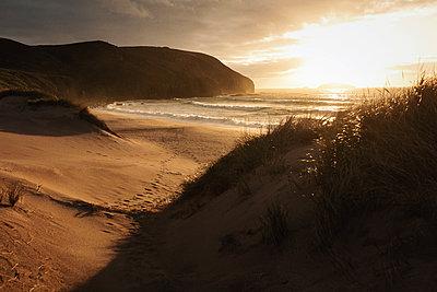 Sandwood Bay at rising sun - p1477m2038967 by rainandsalt