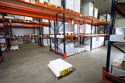 Numbered paper package on pallet in printing warehouse - p429m884713f by Arno Masse