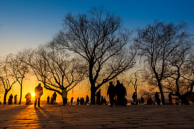 """""""Silhouettes of trees and tourists at sunset, The Summer Palace; Beijing, China"""" - p442m2016274 by Dosfotos"""