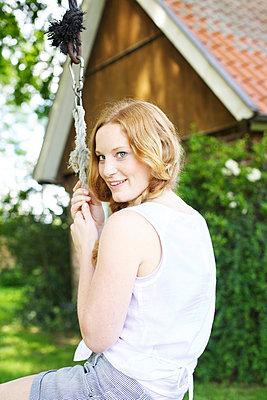 Woman on a swing - p606m919182 by Iris Friedrich