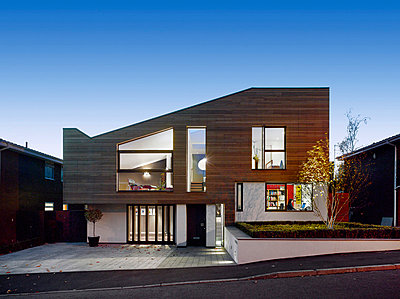 Timber cladding and driveway of building exterior of private house in Worsley, Salford, Greater Manchester, England, UK. - p8552389 by Daniel Hopkinson