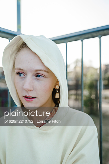 Portrait of teenage girl with hooded shirt - p1628m2210752 by Lorraine Fitch