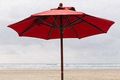 A large beach umbrella on the beach at Manzanita, on the Pacific Ocean in Oregon. - p1100m876190f by Paul Edmondson