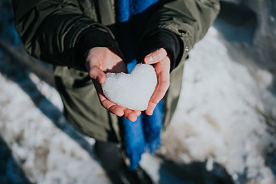 Hands forming heart of snow - p1184m1424121 by brabanski