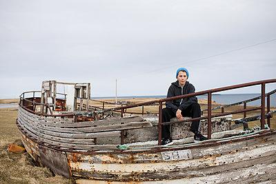 Boy Sitting on Boat - p1503m2015966 by Deb Schwedhelm