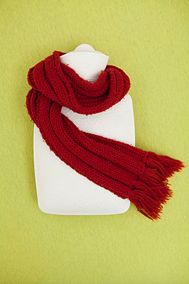 Red scarf and hot-water bottle  - p4540636 by Lubitz + Dorner