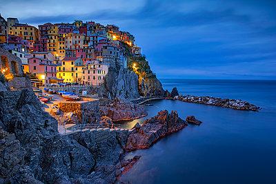 Italy, Liguria, Cinque Terre, Manarola at dawn - p300m1355939 by Herbert Meyrl