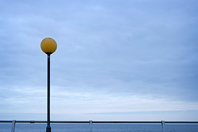 Lamp post looking out to sea - p1228m1123035 by Benjamin Harte