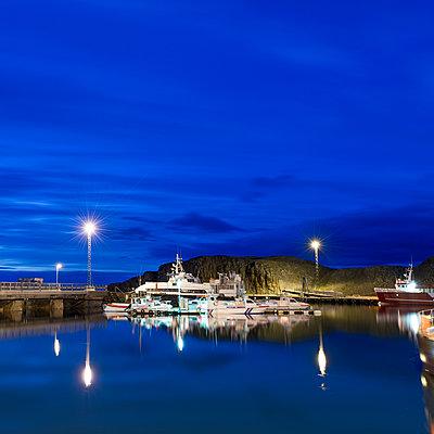Harbour at dusk, Stykkisholmur, Snaefellsnes, Iceland - p429m943125f by Atli Mar Hafsteinsson
