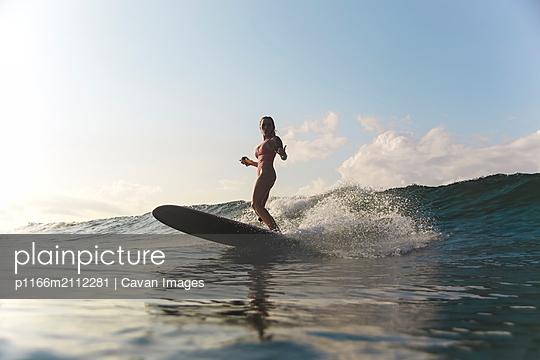 Female surfer in ocean - p1166m2112281 by Cavan Images