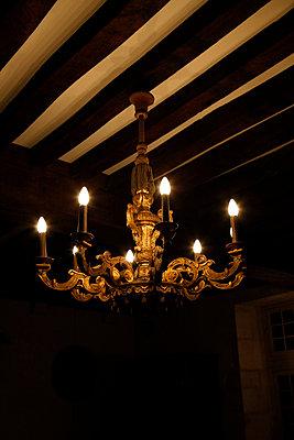 An illuminated chandelier - p301m799753f by Marc Volk
