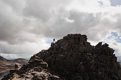 Mountain hiker on a ridge - p1477m2038912 by rainandsalt