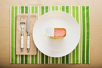 A can of ham on a plate - p9248708f by Image Source