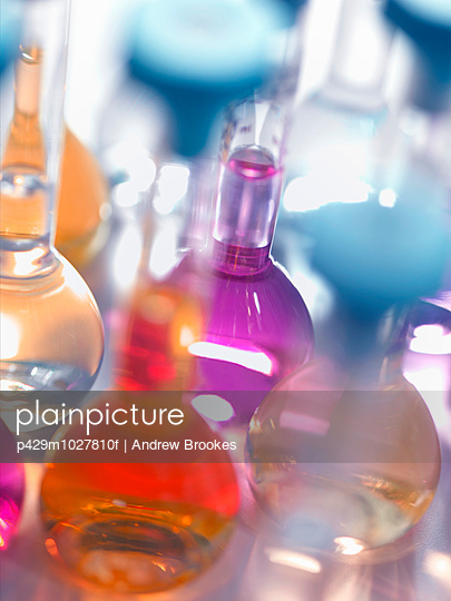 Laboratory glassware flasks containing chemicals in a laboratory - p429m1027810f by Andrew Brookes
