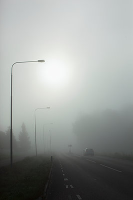 Road in fog - p312m1558051 by Christina Strehlow