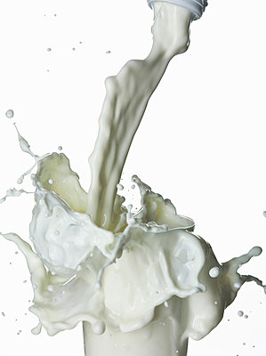 Milk splashing into glass - p429m747227f by Walter Zerla