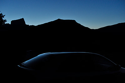 Silhouette of car at twilight - p491m1119192 by Ernesto Timor