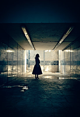 Silhouette of woman standing in underpass - p577m2055199 by Mihaela Ninic
