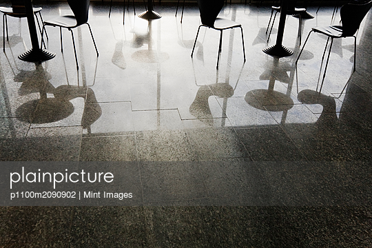 Reflections of Tables and Chairs on Shiny Floor - p1100m2090902 by Mint Images
