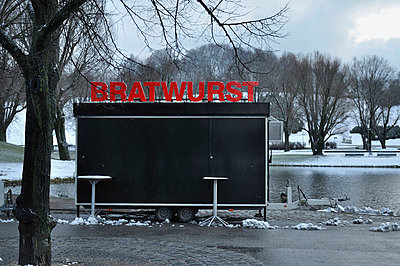 View of closed bratwurst stall - p300m718779f by Axel Ganguin