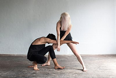 Dancers practising in studio - p429m1054357f by Philippa Langley