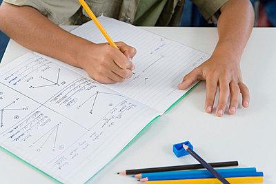 School boy (10-13) writing in classroom - p6090033f by SCHO