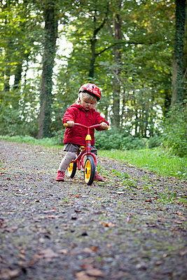 Little girl with bike - p505m951440 by Iris Wolf