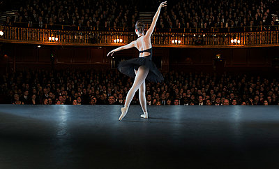 Ballerina performing on stage in theater - p1023m903434f by Martin Barraud
