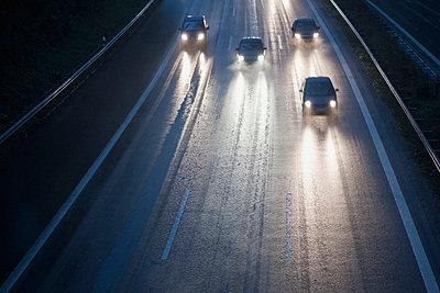 Cars on autobahn during rain - p30020233f by Florian Löbermann