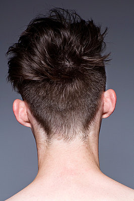 Close up of young man's hairstyle, rear view - p429m824484 by Leland Bobbe