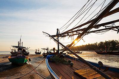 Fishing boats at sunset, Sam Phraya Beach, Khao San Roi Yot National Park, Prachuap Kiri Khan, Thailand, Southeast Asia, Asia - p871m1136161 by Christian Kober