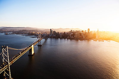 Aerial view of Bay bridge and cityscape against clear sky - p1166m1164432 by Cavan Images