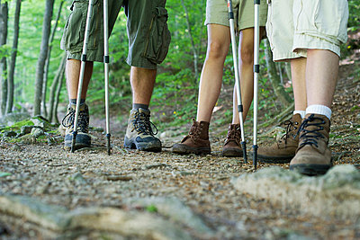 Hikers in hiking boots, low section - p623m699796f by Frederic Cirou